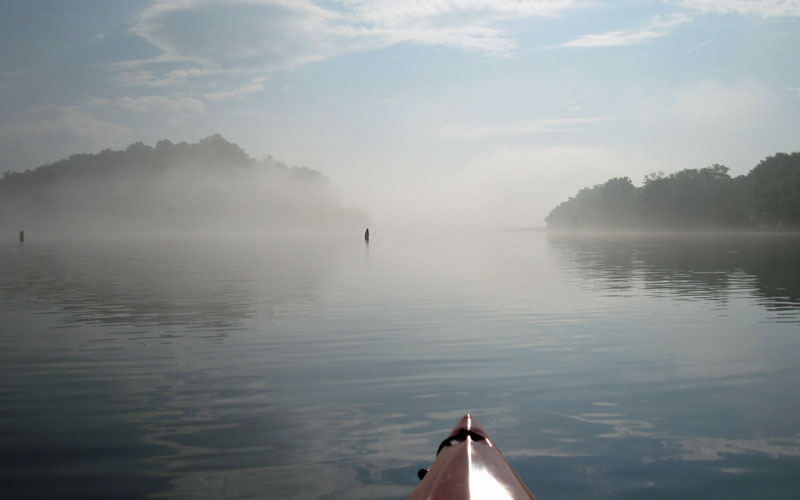 Kayaking on a foggy morning